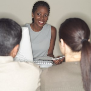 Businesswoman Assisting Customers