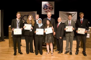 Four Star debate winners with their scholarship awards